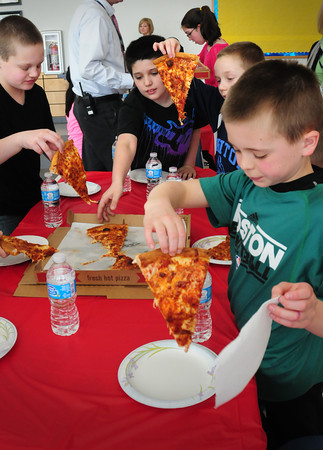 Salisbury: Trays of pizza disappeared rapidly as about 25 students at Salisbury Elementary School participated in at a Massachusetts Children Book Awards Celebration. The students had to read five books from a list of 25 and write several paragraphs on each book they read. Bryan Eaton/Staff Photo