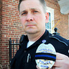 BRYAN EATON/ Staff Photo. Amesbury police officer Jason Kooken is biking for a charity that raises money for the families of law enforcement officer who have died in the line of duty.