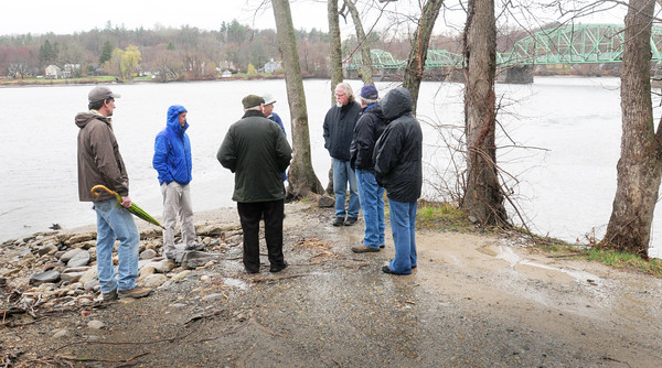 BRYAN EATON/ Staff Photo. The Massachusetts Department of Fish and Game conducted a site visit to the existing boat ramp near Rocks Village Bridge on Wednesday. The purpose was to assess whether the area could accommodate a car top site for kayak and fishing access to the Merrimack River. The state is weighing whether to pay for construction costs to improve the site.  West Newbury sold the shoreline to the state in the late 1960s to construct a boat ramp.  In 1976, a petition with 100 signatures demanded the state make good on its promise, but at that time, funding was not available. In 1998, 300 residents petitioned selectmen to reject a plan to develop the boat ramp area that included paving adjacent town-owned land known as Ferry Lane Park.  Last fall Steve Greason, Chairman of the Open Space Committee, worked with state officials to bring a proposal to selectmen that could have brought in $500,000 in state funds for a new boat ramp, dock, science walk, and parking area.  After receiving push back from the Garden Club and residents living in the area, selectmen formed a task force to research other possible areas of access to the river in town. This spring  34 citizens petitioned selectmen to place an article on the annual warrant that would set aside the Ferry Lane Park triangle as a passive green park in perpetuity.  A second warrant article seeks to rescind town meeting authorization from 1967, which gave selectmen the authority to decide the fate of the Ferry Park area without first seeking town meeting approval.  Voters at the Annual Town Meeting on Monday will take up the two issues under Articles  6 and 7  on the annual warrant. The meeting starts at 7 p.m. in the Town Annex.