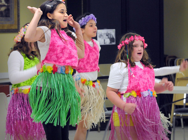 "BRYAN EATON/ Staff Photo. ""The Believers"" dressed in Hawaiian costume perform ""Roar"" for senior citizens at the Hilton Center in Salisbury on Wednesday during their Spring Follies. The Teen Dancers from the Boys and Girls Club also performed several acts."