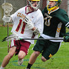 BRYAN EATON/ Staff Photo. Newburyport's Michael Shay runs into a North Reading defender.