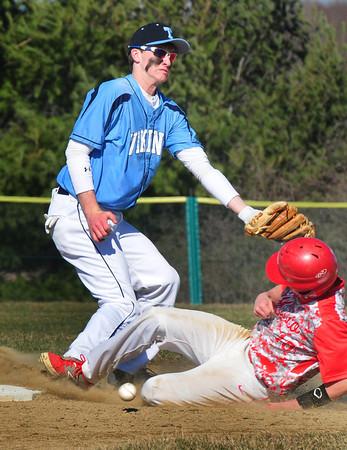 BRYAN EATON/Staff Photo. The ball falls below Triton shortstop Bradley Whitman's reach allowing Masconomet's Dan Dempsey to steal the base.