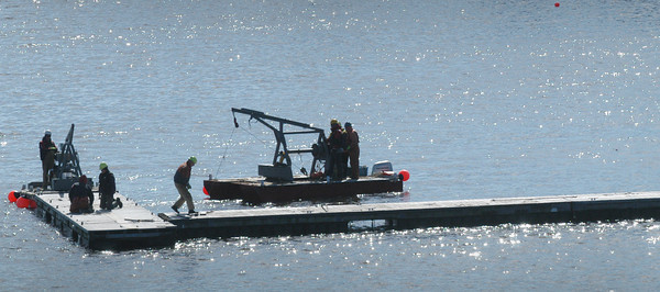 Newburyport: With the weather finally warming people are getting to outdoor activities, here a crew at Windward Yacht Yard install docks in a view from the Gillis Bridge on Tuesday morning. Bryan Eaton/Staff Photo