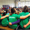 "BRYAN EATON/ Staff Photo. Students embrace as they sing ""Rainbow Connection"" at the Cashman School in Amesbury yesterday before the school body. The school's chorus was performing their spring concert themed The Lion's Pride."