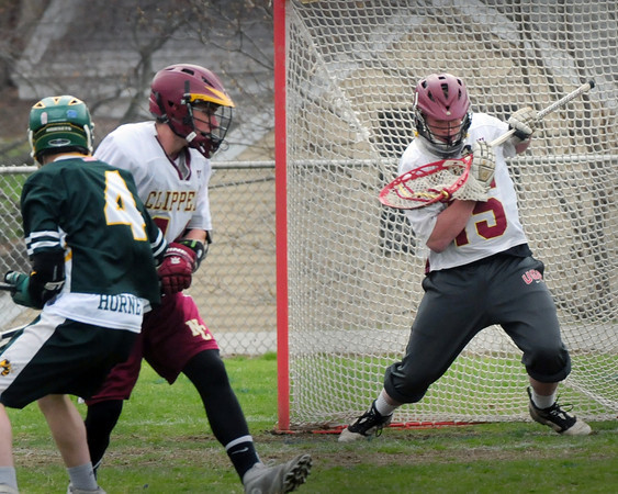 BRYAN EATON/ Staff Photo. Newburyport goalie Dillon Guthro makes a catch on a North Reading shot.