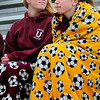 BRYAN EATON/ Staff Photo. May is one day away yet Newburyport High students Abbie Bresnahan, left, and Aly Leahy were bundled up with blankets while watching the boys lacrosse team host North Reading. The cold continues today with rain coming which will bring warmer temperatures into the weekend.