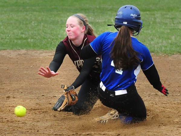 BRYAN EATON/ Staff Photo. Georgetown's Maddy Crateau slides into second on a steal before Newburyport shortstop Morgan Johnston gets the throw.