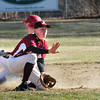 BRYAN EATON/Staff Photo. The ball comes in late to Newburyport second baseman Matthew Short allowing Saugus' Nick Rusconi to steal the base.