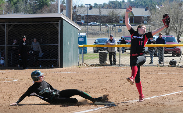 BRYAN EATON/ Staff Photo. Pentucket's Tyler Feeney is safe as she hit a triple against North Andover.