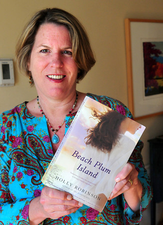 "Rowley: Holly Robinson has written the locally set book ""Beach Plum Island."" Bryan Eaton/Staff Photo"