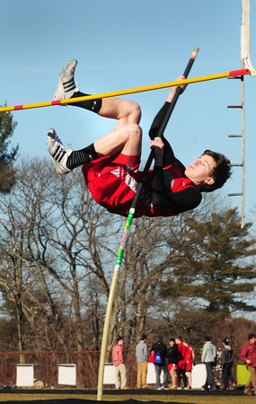 Amesbury: Amesbury's Heath King on his way up for a clean vault. Bryan Eaton/Staff Photo