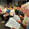 BRYAN EATON/ Staff Photo. An intergenerational men's chorus rehearses last week at Amesbury Middle School.