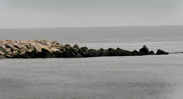 BRYAN EATON/Staff Photo. This photo of the south jetty of the Merrimack River on Plum Island was taken at low tide. There's concern that the rocks to the right could be a hazard to boating at high tide.