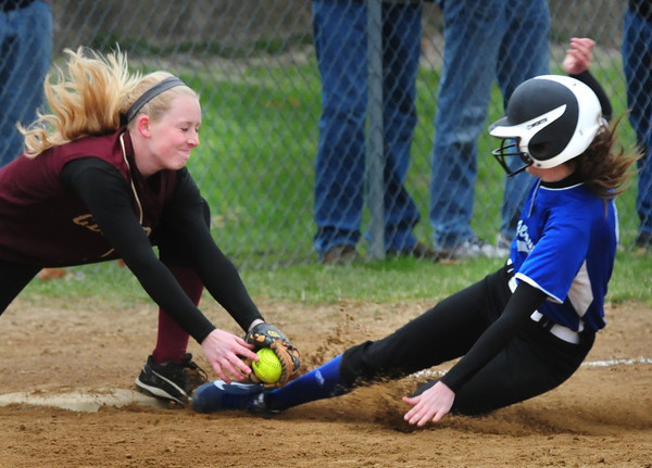 BRYAN EATON/ Staff Photo. Georgetown's Kylie Hayward slides into third base but Newburyport's Shelby O'Brien makes the tag.