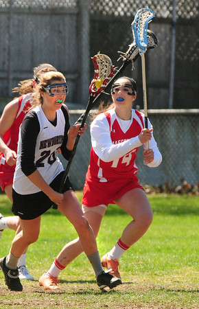 BRYAN EATON/ Staff Photo. Newburyport's Olivia Kearney moves down the field with Masconomet's Sammy Dindo in pursuit.