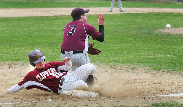 BRYAN EATON/ Staff Photo. Newburyport's Chance Carpenter steals third base against Rockport.
