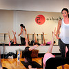 BRYAN EATON/ Staff Photo. Lindsay Zappala leads a class in Barre/Pilates in her Rowley studio.