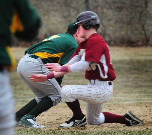 BRYAN EATON/Staff Photo. Newburyport's Chance Carpenter scoots by the North Reading third baseman to safely steal the base.