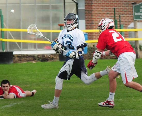 BRYAN EATON/Staff Photo. Triton's Wideburg throws the ball to an open teammate.