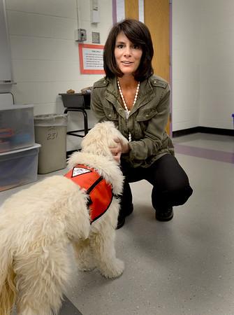 BRYAN EATON/Staff Photo. Nock Middle School teacher Brenda Palmisano brings her therapy dog Skipper to school.