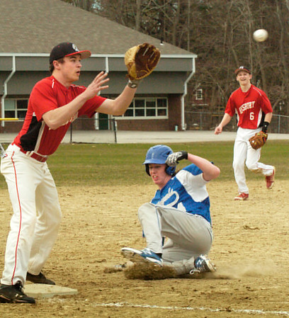 BRYAN EATON/Staff Photo. Georgetown's RIchie Gray is called safe as he slides under Amesbury third baseman Brad Kelleher.