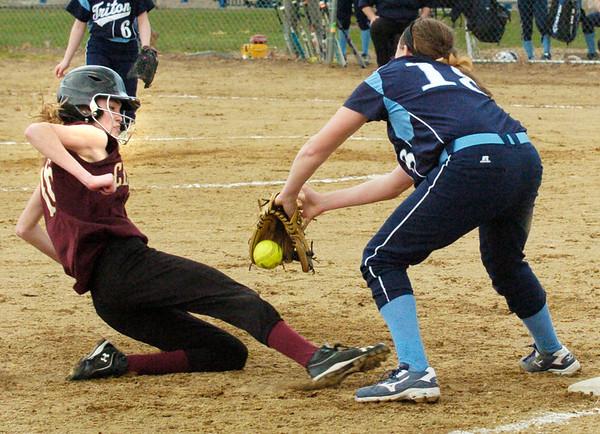 BRYAN EATON/Staff Photo. The ball gets loose from Triton third baseman Emma McGonagle giving Newburyport's Ashley Hodge the base.