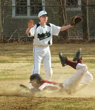 BRYAN EATON/Staff Photo. Pentucket second baseman Noyes holds the through as Newburyport's Ben Keeping eats a little dirt stealing the base.