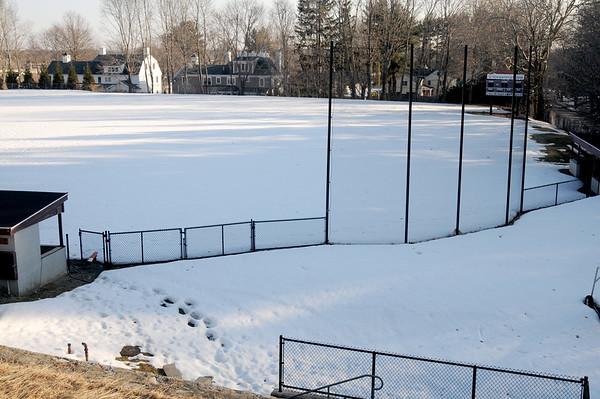 JIM VAIKNORAS/Staff photo Pettingill Field in Newburyport is still covered with snow.