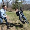 BRYAN EATON/Staff Photo. Jordan Sandman with his son, Maddox, 7, swing in the backyard.