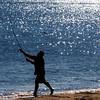 Newbury: A surf caster casts his line off Plum Island Saturday morning. Jim Vaiknoras/Staff photo