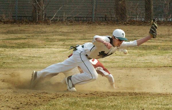 BRYAN EATON/Staff Photo. Newburyport's Chance Carpenter sneaks to second base past Pentucket shortshop DePaolo.