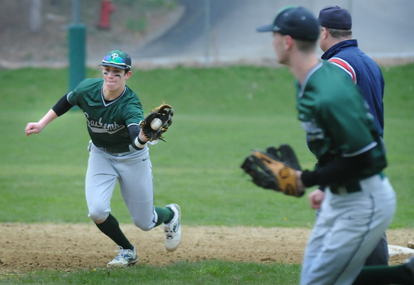BRYAN EATON/Staff Photo. Pentucket second baseman Kiernan Haley picks up a grounder trapping Masconomet's Manni between second and third base.