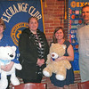 Exchange Club member Erin Fournier, Groveland detective Heather Riley, Exchange member Tracey Garbers and Newburyport inspector Mike Sugrue show off sample stuffed animals for use with children in distress at the club's Tuesday (April 19) meeting at the Starboard Galley.