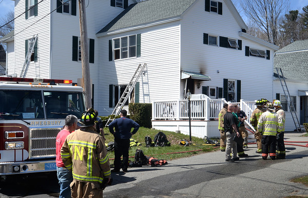 BRYAN EATON/Staff Photo. Quick work by Amesbury and other firefigters saved this home on 17 Maple Street in Amesbury from becoming a total loss after a fire started in the first floor kitcher around 11:30 Thursday morning.