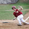 BRYAN EATON/Staff Photo. Newburyport's Wolbach makes his team's first homer of the game.