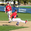 JIM VAIKNORAS/Staff photo  Amesbury's #21 ..Aponas with #17 ..Kelleher hehind him attempts to turn a double play during their game at Patton Park in Hamilton.
