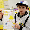 JIM VAIKNORAS/Staff photo  Dominic Torrisi, a student in Bethany Marshall's 2nd grade at the Salisbury Elementary School, dressed as Neil Armstrong for the school's annual Living Museum where kids dressed up as historical figures. Other projects included Nikola Tesla, King Tut, and Moses.