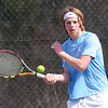 JIM VAIKNORAS/Staff photo Triton's Henrik Ernst returns a ball during his 1st double match at Amesbury. Tennis at Amesbury.