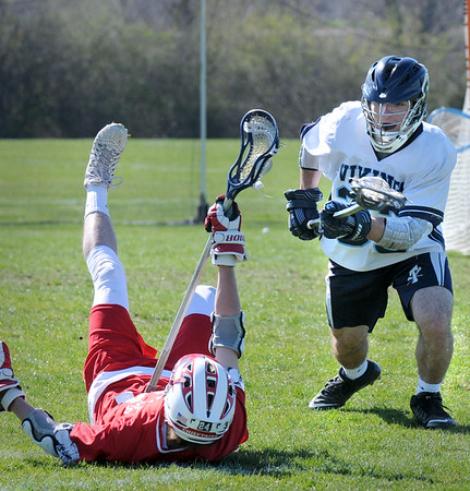 BRYAN EATON/Staff Photo. Triton's Cutter, right, and Masconomet's Gilbert battle for the ball.