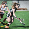 BRYAN EATON/Staff Photo. Newburyport player Olivia Kearney and Pentucket's Grace Dore go for a loose ball.