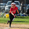 JIM VAIKNORAS/Staff photo Amesbury's Zoe Fitzgerald watches as she get a base hit against Georgetown at Amesbury.