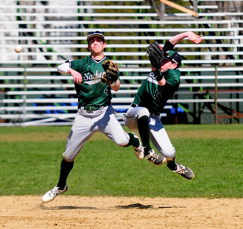 JIM VAIKNORAS/Staff photo #11 Steve Noyes avoids colliding with #4  Kiernan Haley as he throws out a North Reading runner during their game at pentucket Saturday.