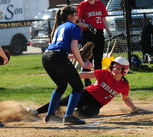 JIM VAIKNORAS/Staff photo Amesbury's  Hayley Catania slide safetly home against Georgetown at Amesbury.