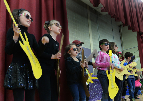 "BRYAN EATON/Staff Photo. Youngsters at the Cashman School in Amesbury perform ""Meteor Shower"" to the school body on Wednesday morning. They were presenting the play ""Spaced Out"" which is about the solar system which they've been studying."
