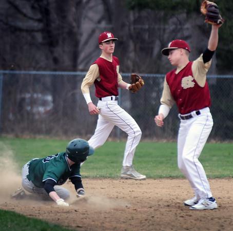BRYAN EATON/Staff Photo. Newburyport second baseman Hadden has the ball though Pentucket's Jacob Deziel was safe on the steal.