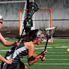 BRYAN EATON/Staff Photo. Newburyport's Molly Rose Kearney knocks the ball from Pentucket's #12's stick.