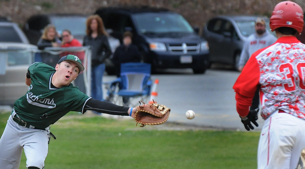 BRYAN EATON/Staff Photo. Pentucket first baseman Mitch Murray reaches for a wide throw allowing Masconomet's Romanowski to make the base.