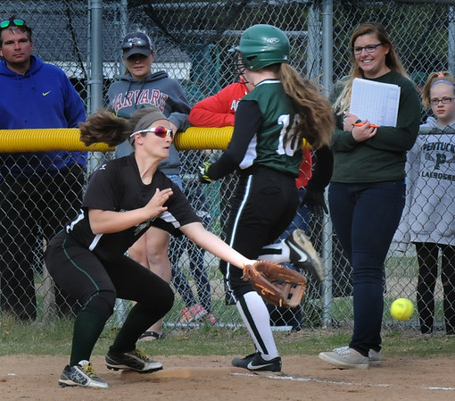 BRYAN EATON/Staff Photo. The ball gets by Pentucket's 18 allowing Manchester Essex runner Ainsley McLaughlin a base hit.