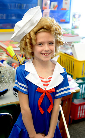 JIM VAIKNORAS/Staff photo  Sydney Champagne, a student in Kelly Clayton's 2nd grade at the Salisbury Elementary School, dressed as Shirley Temple for the school's annual Living Museum where kids dressed up as historical figures. Other projects included Nikola Tesla, King Tut, and Moses.