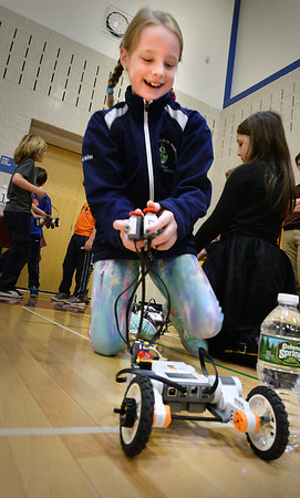 BRYAN EATON/Staff Photo. Erin Casco, 8, crosses the finish line with a Lego NXT robot at the Bresnahan School at a booth manned by the Newburyport High School Engineering and Robotics class. The school was holding a STEM (Science, Technology, Engineering and Math) Expo to stir curiosity in those subjects.